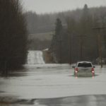 The Aroostook River spills over its banks in a 2009 file photo.
