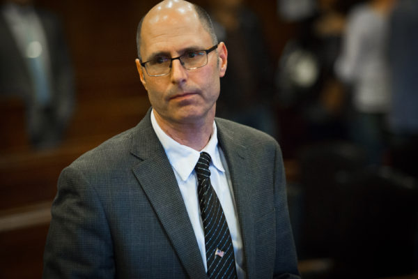 Gregory Nisbet stands up after he was found not guilty of manslaughter by Cumberland County Superior Court Justice Thomas Warren. Nisbet is the landlord who owned the Portland building where six young adults died in a fire in 2014.