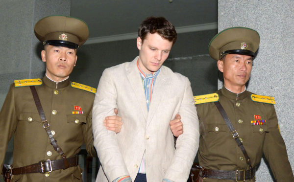 Otto Frederick Warmbier (center), a University of Virginia student who was detained in North Korea since early January, is taken to North Korea's top court in Pyongyang, North Korea, in this photo released by Kyodo on March 16, 2016.