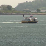 A ferry crosses Casco Bay.