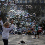 A street artist performs with soap bubbles at Rossio square in downtown Lisbon, Portugal April 28, 2017.