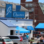 The owner of J's Oyster Bar in Portland has agreed to plead guilty to tax evasion and pay the state government more than $1 million in back taxes.