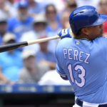 Kansas City Royals' Salvador Perez follows through on a single in the second inning during Wednesday's baseball game against the Boston Red Sox at Kauffman Stadium in Kansas City, Missouri.