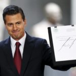 Mexico's President Enrique Pena Nieto shows a document after announcing the government plans to legalize marijuana-based medicines, and proposed raising the amount of the drug that can be legally carried, in the wake of a national drug policy review, in Mexico City, Mexico, April 21, 2016.