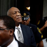 Actor and comedian Bill Cosby stands as his publicist, Andrew Wyatt, addresses the media after a judge declared a mistrial in Cosby's sexual assault trial at the Montgomery County Courthouse in Norristown, Pennsylvania, U.S. June 17, 2017.