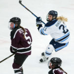 University of Maine's Tereza Vanisova (right) moves in position around Union College's Ava Reynolds during their hockey game in December.