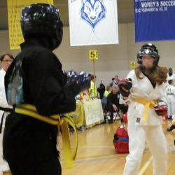 Caitlyn Moeykens (right) of Orono competes in a recent Tae Kwon Do tournament in Gorham. Moeykens, 13, is one of three Old Town YMCA students who have qualified for a tournament in Cancun, Mexico, early in 2019.