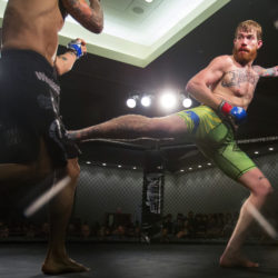 Devin Powell (right) kicks Team Irish MMA Fitness Academy's Jon Lemke in the leg during their catchweight bout as part of the reality program &quotDana White: Lookin' For A Fight&quot event at the Cross Insurance Center in August 2016.