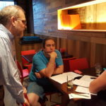 Bangor Savings Bank Senior Vice President Scott Blake gives project idea advice to Bangor residents Aubrae Ramiak and Jared Hunnefeld of the Innovative Communities competition's Abraham Lincoln School team on June 20 at the Blaze restaurant in Bangor.