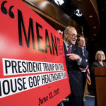 "Senate Minority leader Chuck Schumer, written ''ER'' to make the poster read ""Meaner'' during his press conference on the Senate Republicans' health care bill with Sen. Patty Murray, and Sen. Ron Wyden, in the Capitol on June 22, 2017."