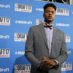 Markelle Fultz stops for photographers while walking the red carpet before the start of the NBA Draft at the Barclays Center in Brooklyn, New York, on Thursday, June 22, 2017.