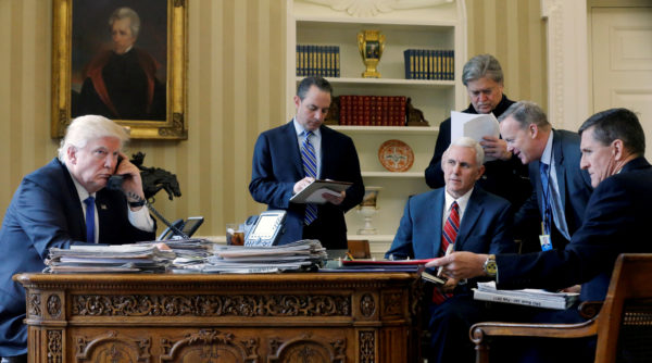U.S. President Donald Trump (L-R), joined by Chief of Staff Reince Priebus, Vice President Mike Pence, senior advisor Steve Bannon, Communications Director Sean Spicer and then National Security Advisor Michael Flynn, speaks by phone with Russia's President Vladimir Putin in the Oval Office at the White House in Washington, U.S. January 28, 2017.