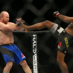 Jacare Souza (red gloves) fights Tim Boetsch (blue gloves) during UFC 208 at Barclays Center, Feb. 11, 2017.