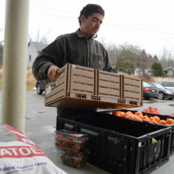 Farmer Michael Hayden of Folklore Farm in Cherryfield sets up his pop-up farm stand for children to come select vegetables to take home with them at Milbridge Elementary School in Milbridge, Jan 12, 2017.