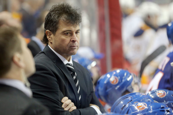 Former New York Islanders head coach Jack Capuano coaches against the Buffalo Sabres during the second period at Barclays Center.