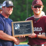 Orono High School's Jackson Coutts (right) receives the Dr. John Winkin Award as Maine's Mr. Baseball from Nick Caiazzo, president of Maine Baseball Coaches Association, at Colby College in Waterville on Friday.