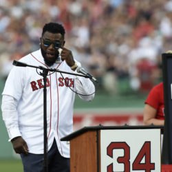 Former Boston Red Sox designated hitter David Ortiz wipes tears during ceremonies for retiring his No. 34 before a game against the Los Angeles Angels at Fenway Park in Boston on Friday night.