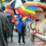 Umbrellas helped spectators watching the Bangor Pride parade wind its way into downtown Bangor on Saturday.