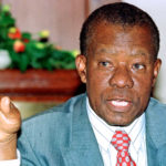 Former president of Botswana Ketumile Masire, speaks to the media at a news conference in Nairobi, Kenya, May 16, 2000.