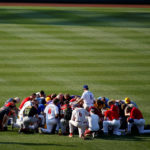 Members of the Republican team pray before the Democrats and Republicans face off in the annual Congressional Baseball Game at Nationals Park in Washington, June 15, 2017.