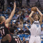 Dallas Mavericks forward Dirk Nowitzki (41) shoots the ball over Portland Trail Blazers center Mason Plumlee (24) during the first quarter at the American Airlines Center.