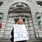 Beth Kohn protests against U.S. President Donald Trump's executive order travel ban, outside the 9th U.S. Circuit Court of Appeals courthouse in San Francisco, California, Feb. 7, 2017.
