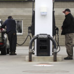 Customers pump gas at a Brewer gas station in April 2016.