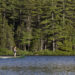 Eric Martin, 25, of Orono, and Morgan Cushing, 23, of Glenburn, fish from canoe on June 21, on Branch Lake in Ellsworth. Much of the lake's shore is undeveloped and open to the public thanks to conservation efforts by local organizations, the town of Ellsworth and funding from Land for Maine's Future. The 239-acre Branch Lake Public Forest is part of a 1,164-acre conservation area and public forest that includes a 3.1-mile network of hiking trails and a hand carry boat launch site.
