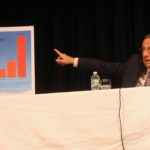 Maine Gov. Paul LePage points out some energy statistics at a Town Hall meeting at the University of Maine at Fort Kent, April 25.