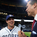 San Diego Padres right fielder Hunter Renfroe (10) smiles as he is interviewed by Fox reporter Bob Scanlan (R) after hitting a walk off home run to beat the Milwaukee Brewers 6-5 at Petco Park.