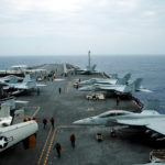 F/A-18 Hornet fighter jets and E-2D Hawkeye plane are seen on the U.S. aircraft carrier John C. Stennis during joint military exercise called Malabar, with the United States, Japan and India participating, off Japan's southernmost island of Okinawa, Japan, June 15, 2016.