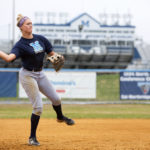 University of Maine's Alyssa Derrick throws a ball to first during  softball practice in April.