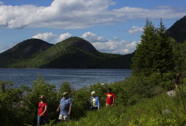 People enjoy the views near Jordan Pond in Acadia National Park, June 30, 2016.