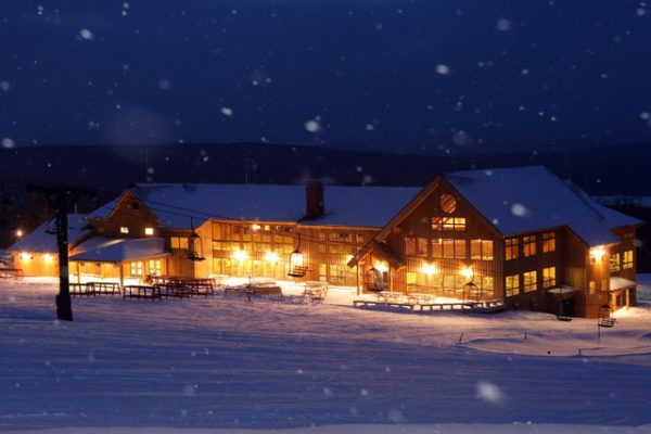 The Saddleback Mountain Resort lodge, shown at night.