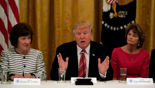 U.S. President Donald Trump meets with Senate Republicans about healthcare in the East Room of the White House in Washington, U.S., June 27, 2017. Trump is flanked by Senators Susan Collins (R-ME) and Sen. Lisa Murkowski (R-AK).