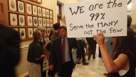 Republican House Minority Leader Ken Fredette of Newport makes his way to the House floor through a throng of protesters at the State House on Tuesday, June 27, 2017.