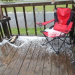 Hail is visible on the deck of Presque Isle resident James Robinson after scattered storms across the state brought both hail and lightning throughout Tuesday, June 27, 2017. There was some damage after lightning sparked a house fire in Cushing and struck a business in Thomaston.