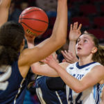 Sigi Koizar (right) of the University of Maine, pictured during a game in February 2017, recently signed a contract to play professional basketball in Hungary.