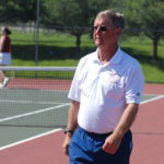 Ellsworth tennis coach Brian Higgins celebrates his 600th victory.