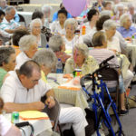 About 100 senior citizens and health care advocates celebrate the 45th anniversary of the creation of Medicare during a luncheon Thursday at First United Methodist Church on Essex Street in Bangor, July 29, 2010.