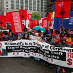 """Cooks, cashiers and other minimum wage earners join anti-Trump activists on a march for an increase in the minimum wage during a """"March on McDonald's"""" in Chicago, Illinois, May 23, 2017."""