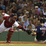 Minnesota's Joe Mauer slides safely past the tag of Boston catcher Christian Vazquez during the fourth inning of Thursday's game at Fenway Park in Boston. The Red Sox won 6-3. Bob DeChiara | USA TODAY Sports