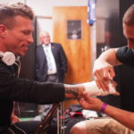 Mixed Martial Arts fighter Bruce Boyington of Brewer (left) gets his hands taped by teammate Ray Wood prior to a 2014 fight in Massachusetts.