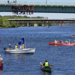 Kayakers and canoeist take part in a flotilla on the Penobscot River during a rally in support of the Penobscot Nation.