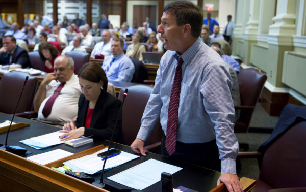 House Minority Leader Ken Fredette (right), R-Newport, answers a question to the House during the House of Representatives vote on the state budget at the Maine State House in Augusta. Lawmakers are scurrying to avoid a state government shutdown.