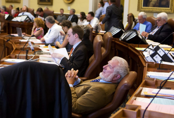 Sen. Dave Woodsome (right), R-North Waterboro, leans back in his chair while listening to arguments during the Senate's hearing on the state budget at the Maine State House in Augusta. Lawmakers are scurrying to avoid a state government shutdown.