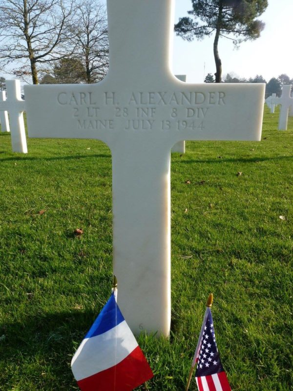 READFIELD, Maine -- 2nd Lt. Carl Alexander's grave at Normandy American Cemetery in France. After suffering mortal wounds in Rennes during World War II, he told medics to help another wounded officer and finished giving orders to his men before dying moments later. He posthumously was awarded the Silver Star and Purple Heart.