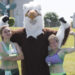 "Celebrate Husson! events kick off on Saturday, June 24 with a ""Run for the Gold."" This fun run is divided into four major categories. For adults, there's a 5K run. There's also a student version of the 5K run.  In this photo, Husson's mascot congratulates two of last year's runners."