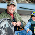 2016 Lifetime Outdoor Achievement Award recipient Gary Cobb teaching his grandson Lyle to fish.