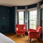The rooms at the 1922 Higgins Beach Inn have been modernized with touches such as flat-screen TVs, AC and interior updates like pickled walls, plush chairs and vintage Maine tourism signs.